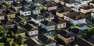 Colorful houses in a row real estate investing