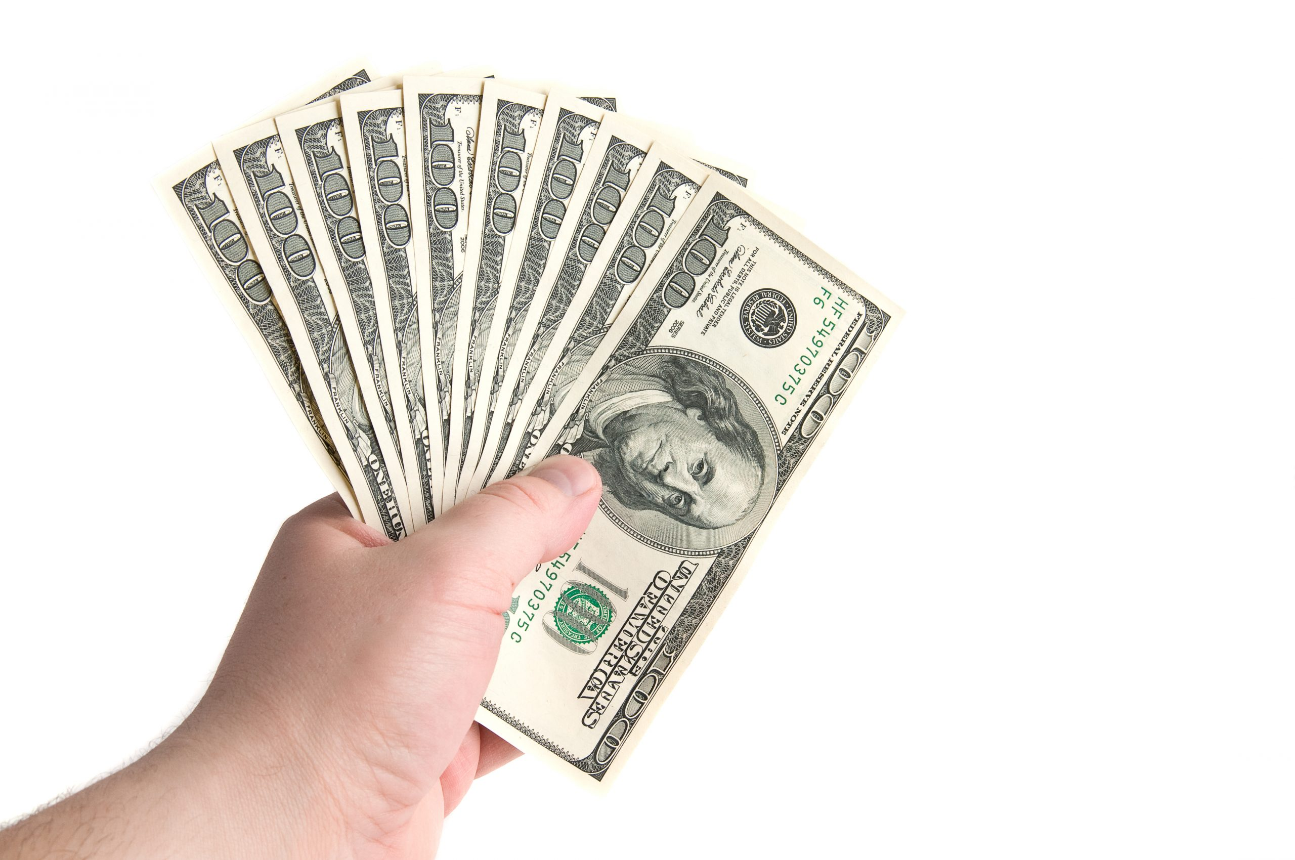 """hand holding one thousand dollars. this image is pictured in a passive income md blog titles """"7 ways to make an extra $1000 a month"""""""